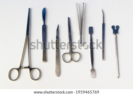 A top view of a stainless dissection kit on a white background Zdjęcia stock ©
