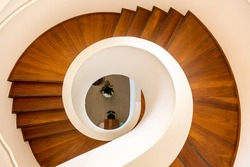 A top view of a wooden spiral staircase in a private house