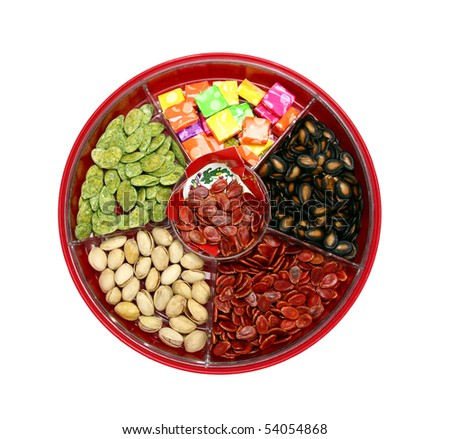 A top view of Chinese candy box. It is used for Chinese New Year, it consists different kinds of candies, chocolate coins, melon seeds, sugar preserved dried fruits or even dried vegetables.