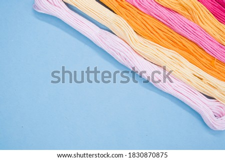 A top view of colorful mouline threads isolated on a blue background Photo stock ©