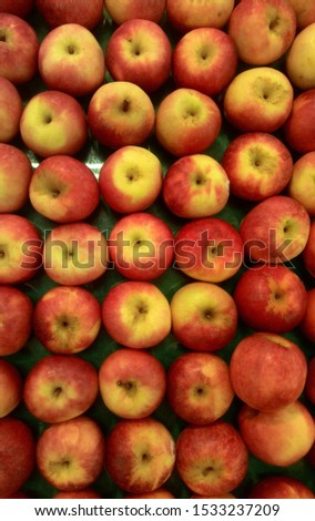 A top view shot of apples on a market display.