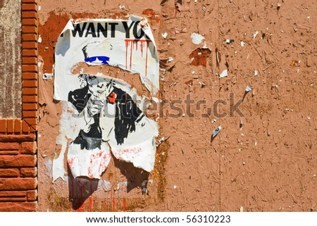 A torn poster of Uncle Sam, \
