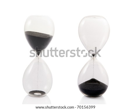 A totally clear hourglass in two stages: as the black sand begins to fall and as it ends.  Isolated on white.