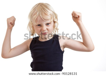 A tough cute boy boy flexing his muscles. Isolated over white. - stock photo