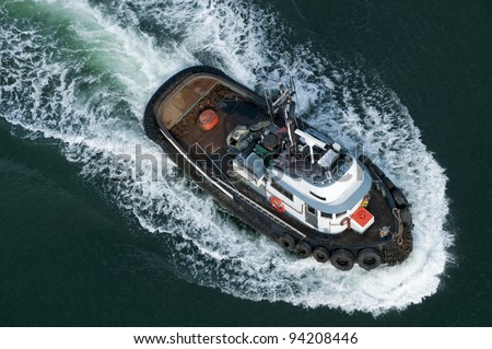 A tough little tugboat seen from above. - stock photo