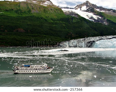 A tour boat approaches Havard Glacier in College Fjord, Alaska.