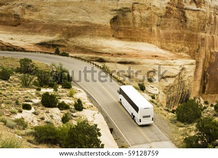 A tour bus drives through the scenery along the Rim Rock Drive in Colorado National Park.