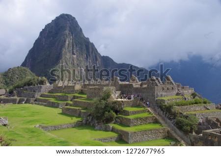 A tour group tours the grounds of Machu Picchu, Peru. #1272677965