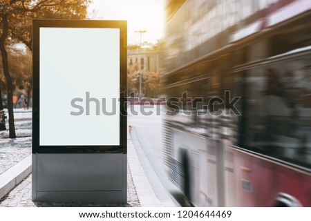 A tourist double-decker is passing by at a high speed near empty urban billboard mockup; two-decker full of tourists near the bus stop with the template of clean city information banner placeholder Сток-фото ©