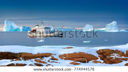 A tourist icebreaker moored off the north west coast of the Svalbard Islands (Spitsbergen) in the high Arctic. The Svalbard Islands came under Norwegian sovereignty in 1925.