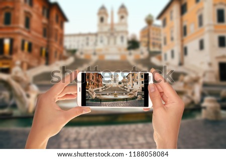 A tourist is taking a photo of Spanish Steps in the Plaza of Spain in Rome in the early morning without people on a mobile phone #1188058084