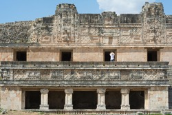 A tourist photographs the structures of Uxmal's ruins in Merida Yucatan.