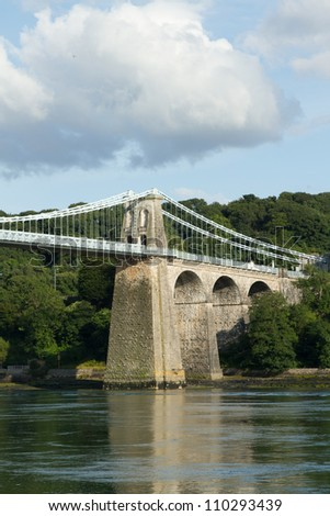 A tower and arches of the historic Menai Suspension bridge over the Menai Straits, Gwynnedd, Wales, UK.