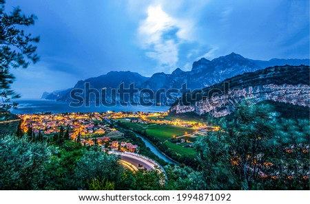 A town in the mountains on the beach late in the evening. Mountain sea bay town in evening. Mountain sea town panorama
