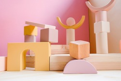 A town made of elements of a wooden children's designer of pastel colors. The idea of architecture, urban environment, creativity, sustainable design, eco-friendly lifestyle.