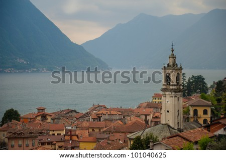 A town with a bell tower overlooking Lake Como, Italy