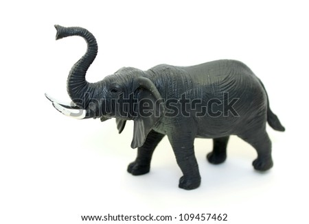 A toy elephant on white background