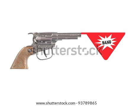 A toy hand gun isolated against a white background