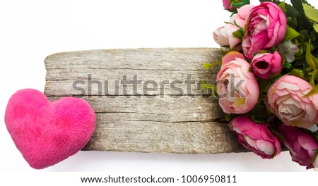 a toy heart on a simple wooden background, a bouquet of roses with free space for text #1006950811