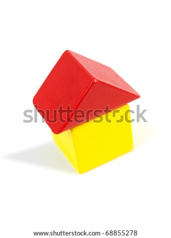 A toy house made from building blocks - stock photo
