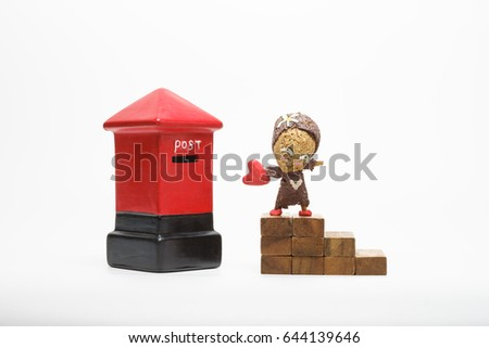 a toy man sent lovecard heart in the postbox #644139646