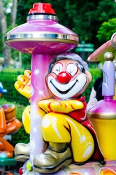 A toy smiling sitting clown in the amusement park