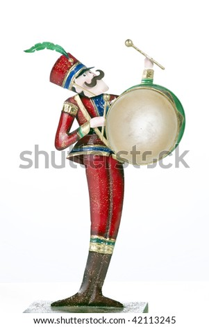 A toy soldier drum player isolated against a white background in the vertical format.