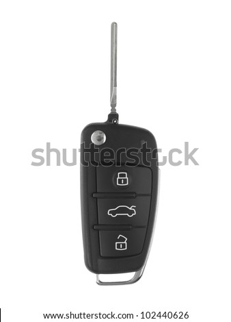 A toy sports car key isolated against a white background