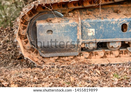 A track on a track hoe.