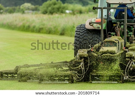 A tractor being used to cut grass at a commercial turf growing farm in Scotland.