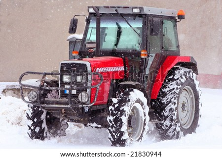 A tractor in snow on a winter day