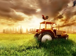 a tractor on the grass field
