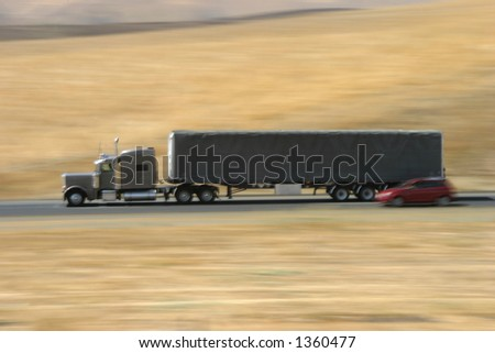 A tractor-trailer hauls some stuff down the highway.