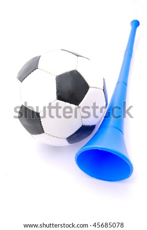 A traditional black and white football with a blue original South African Vuvuzela soccer fan horn. Image isolated on white studio background.