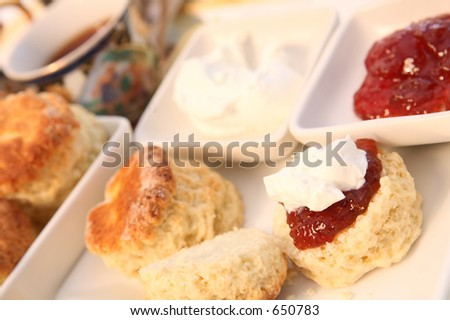 A traditional British cream tea, with scones, jam, cream and a cup of tea