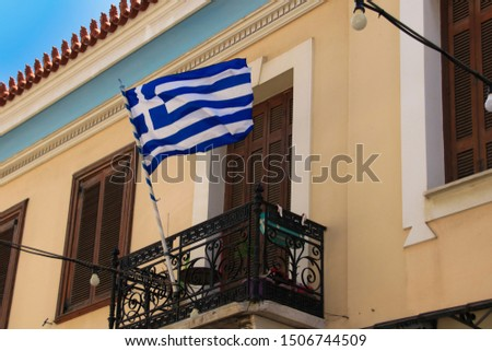 A traditional greek balcony with a greek national flag. Athens - Greece