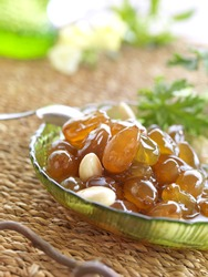 a traditional Greek dessert, boiled white grape berries and peeled almonds with water and sugar