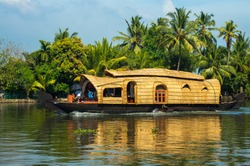 A traditional houseboat for river tours in the Kerala backwaters, India