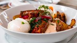 A traditional Hungarian food called Rakott Krumpli (scalloped potatoes). Potatoes, sausages, sour cream, and eggs.