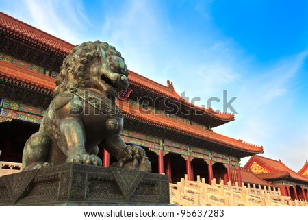 A traditional Imperial guardian lion at the Gate of Supreme Harmony at sunset in Forbidden City. Beijing, China.
