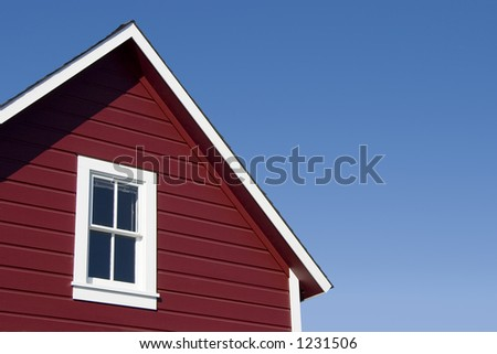 A traditional looking red house roof.