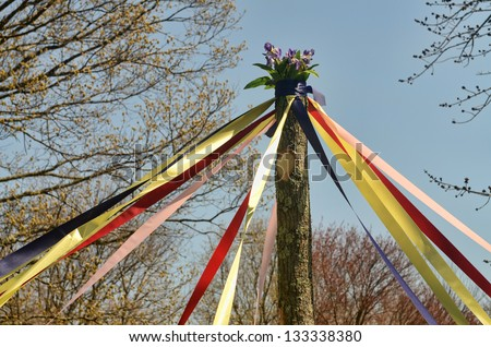 A traditional maypole dance during a May Day celebration #133338380