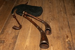 A traditional musical instrument bagpipe on the wooden floor.
