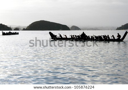 A traditional New Zealand Maori waka boat on the sea in the Bay of islands, New Zealand.