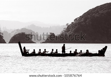A traditional New Zealand Maori waka boat on the sea in the Bay of islands, New Zealand. - stock photo