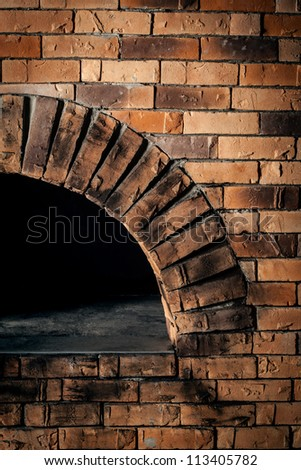 A traditional oven for cooking and baking pizza. - stock photo