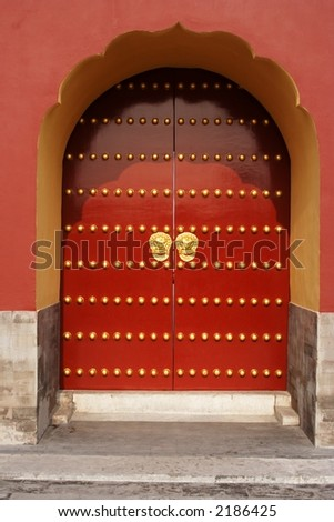 A traditional red door at Temple of Heaven in Beijing, China.