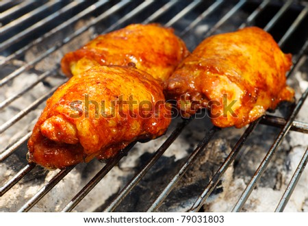 a traditional style bbq with chicken cooking on the grill