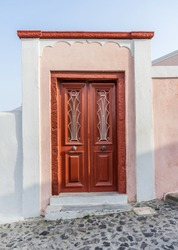 A traditional wooden door in the village of Oia in Santorini island, Greece.
