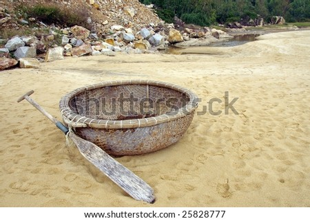A traditional woven basket boat at a beach in Vietnam #25828777